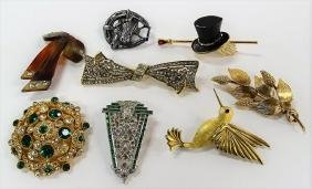 LARGE LOT OF COSTUME PINS/CLIPS