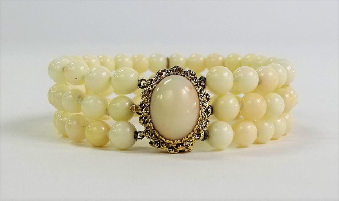 LADIES 14KT YELLOW GOLD WHITE CORAL BRACELET