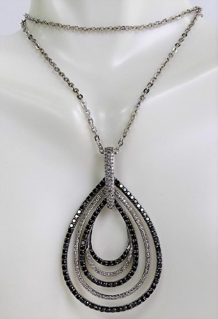 18 KT W. GOLD BLACK AND WHITE 1CT DIAMOND NECKLACE