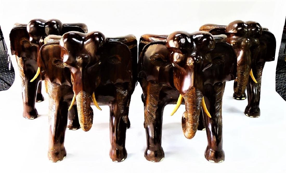 FOUR VINTAGE CARVED WOOD ELEPHANT FORM CHAIRS