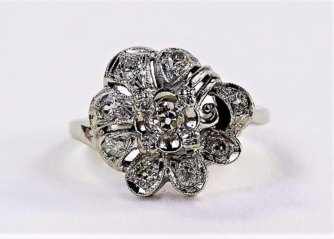 LADIES 14KT WHITE GOLD FLORIFORM DIAMOND RING