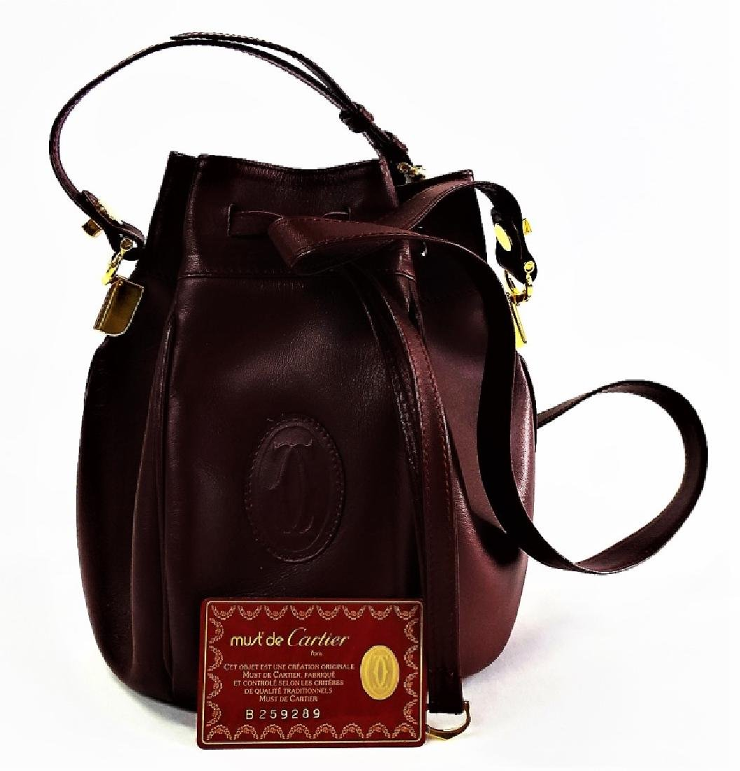 CARTIER BURGUNDY LEATHER DRAWSTRING BUCKET BAG
