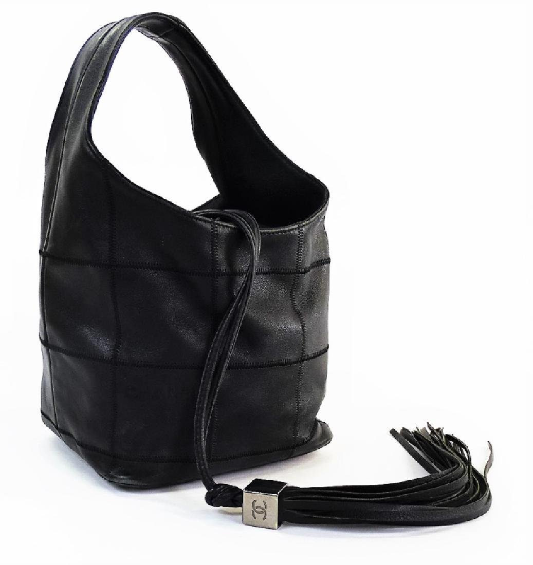 CHANEL SURPIQUE LEATHER DRAWSTRING BUCKET BAG