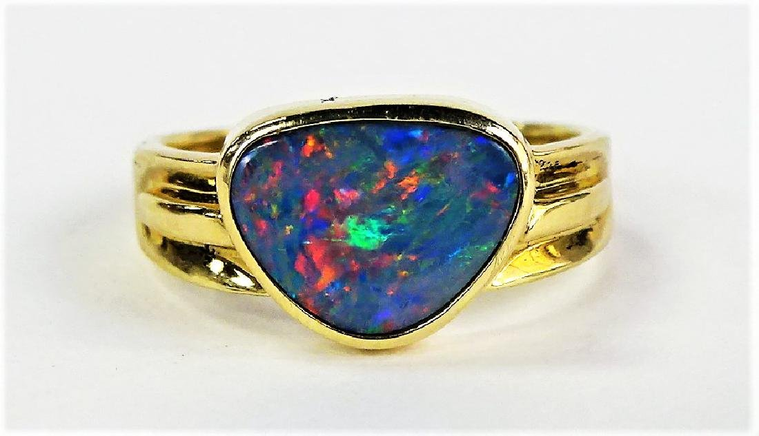 LADIES 14KT YELLOW GOLD FIRE OPAL RING