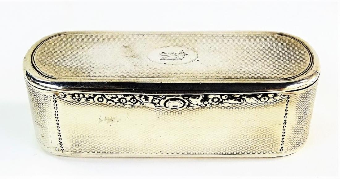 A GEORGE III OVAL STERLING SILVER TOBACCO BOX