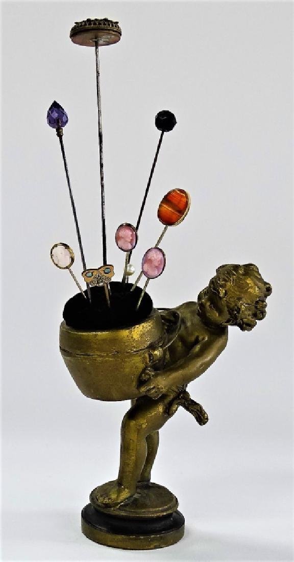 ANTIQUE BRONZE PUTTI FIGURAL PIN CUSHION