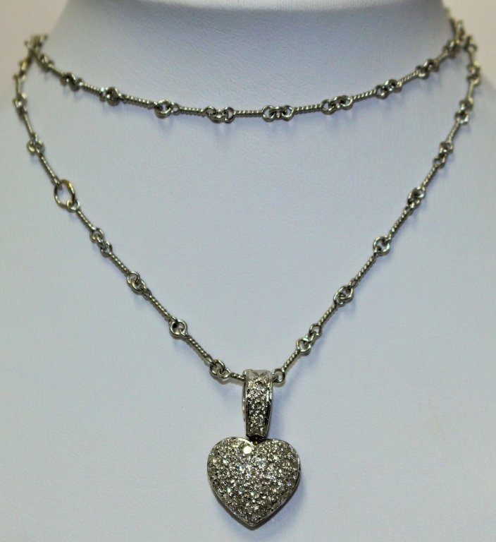 ESTATE PLATINUM AND 1 1/4CT DIAMOND HEART NECKLACE