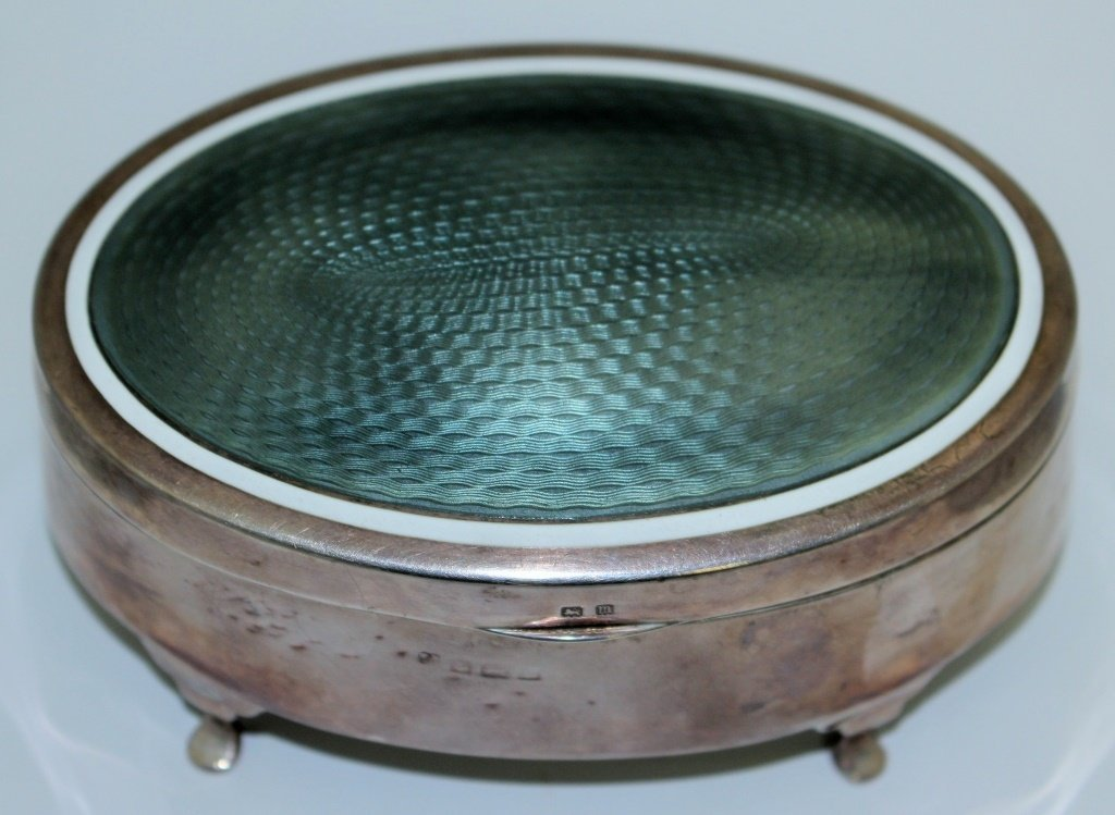 ENGLISH STERLING AND GUILLOCHE OVAL FOOTED BOX