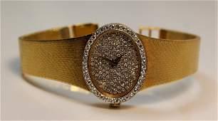 ESTATE 18KT YG & DIAMOND CHOPARD LADIES GOLD WATCH