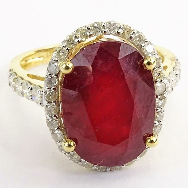 GGA CERTIFIED 9.05 CT OVAL CUT RUBY AND 14KT RING