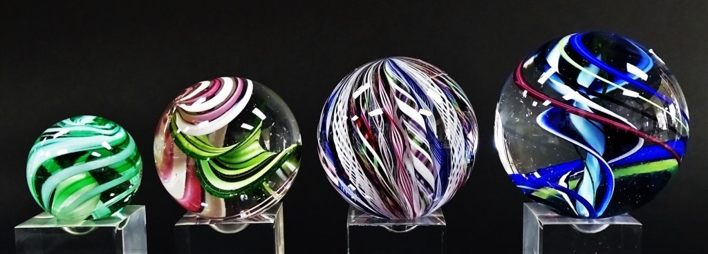 GROUP OF 4 SIGNED ART GLASS ORBS ON STANDS - 2