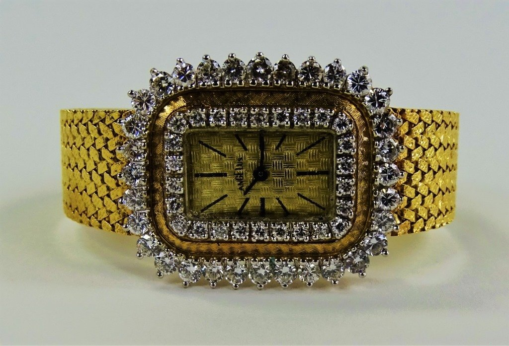 LADYS VINTAGE ANGELUS 14KT GOLD DIAMOND WATCH