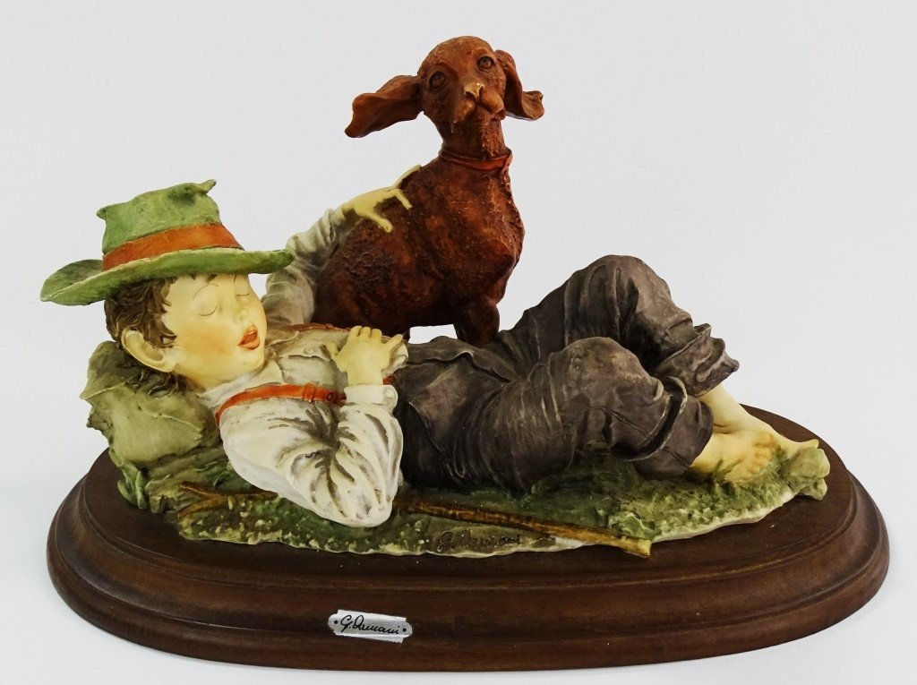GIUSEPPE ARMANI FIGURINE OF A BOY LAYING WITH DOG