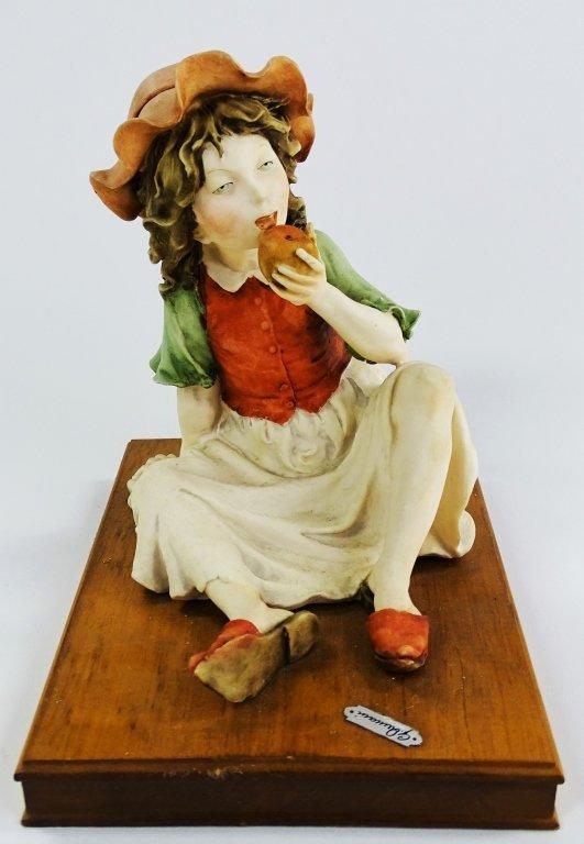 GIUSEPPE ARMANI FIGURINE OF A LADY EATING APPLE