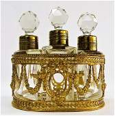FRENCH TRIPLE FITTED PERFUME BOTTLE CLUSTER