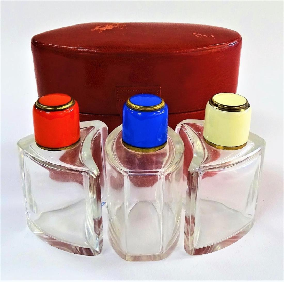 3 CRYSTAL SCENT BOTTLES WITH ENAMELED TOPS IN CASE