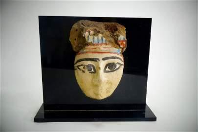 An Egyptian Wood Painted Mummy Mask
