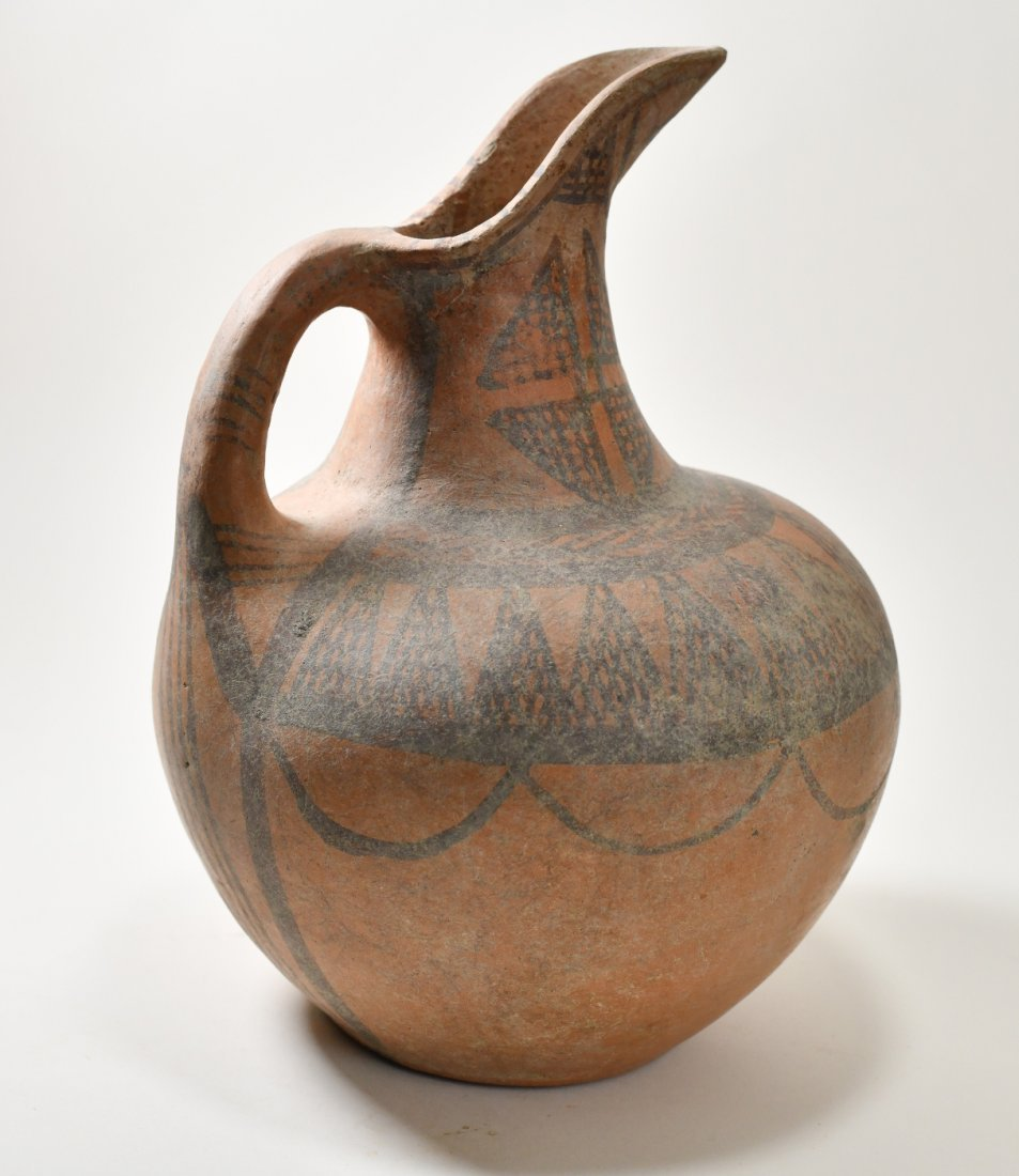 An Early Minoan Decorated Spouted Terracotta Jug