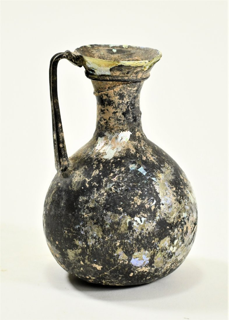 A Roman Iridescent Glass Jug