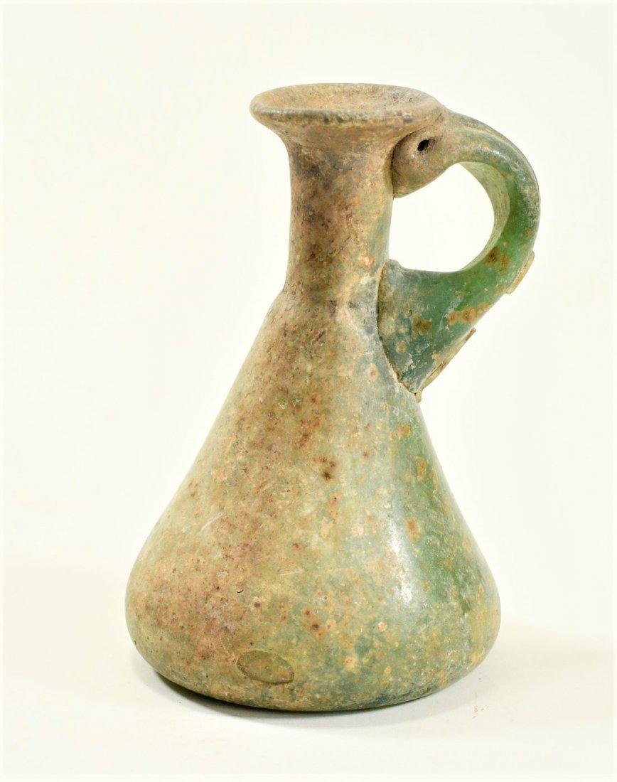 A Roman Green Glass Jug