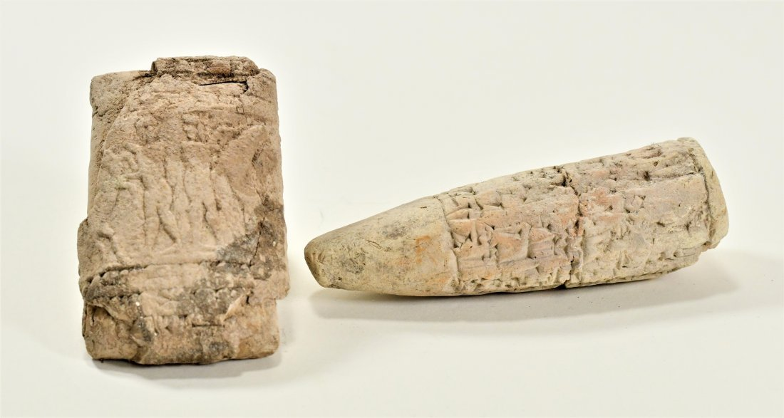 A Near Eastern Clay Cuniform Cone & Clay Relief Tablet