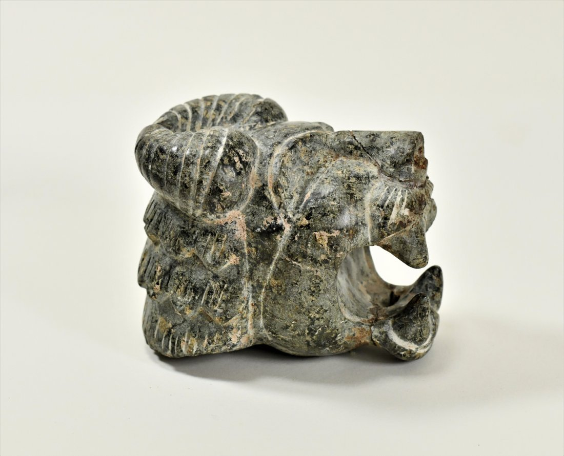 A Neo-Assyrian Stone Head of a Roaring Lion