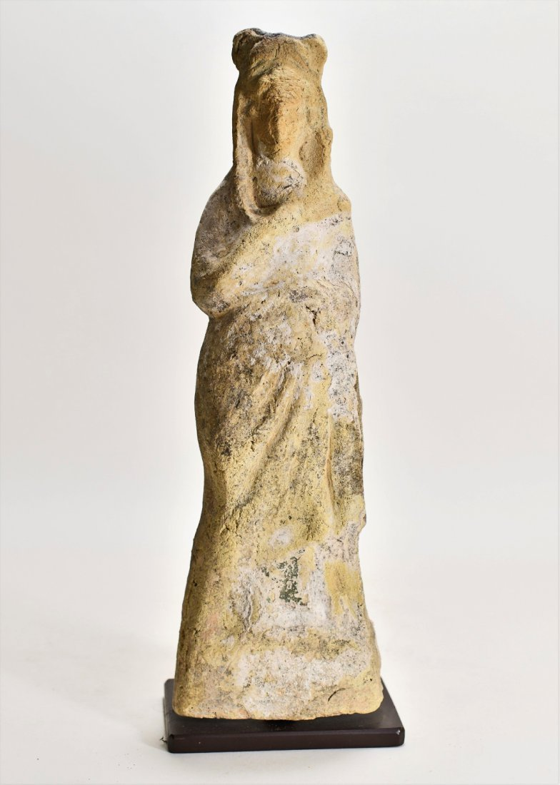 A Large Greek Female Standing Pottery Figure
