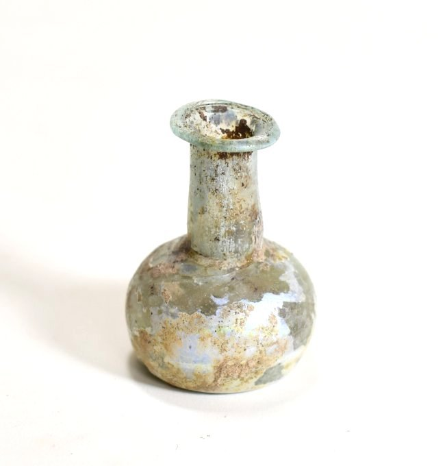 A Roman Glass Flask with Indented Bottom