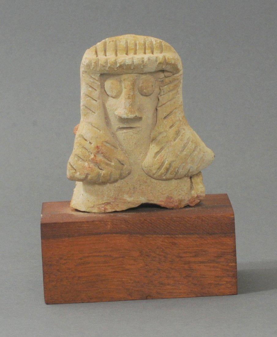 ANCIENT NEAR EASTERN TERRACOTTA BUST OF A FEMALE