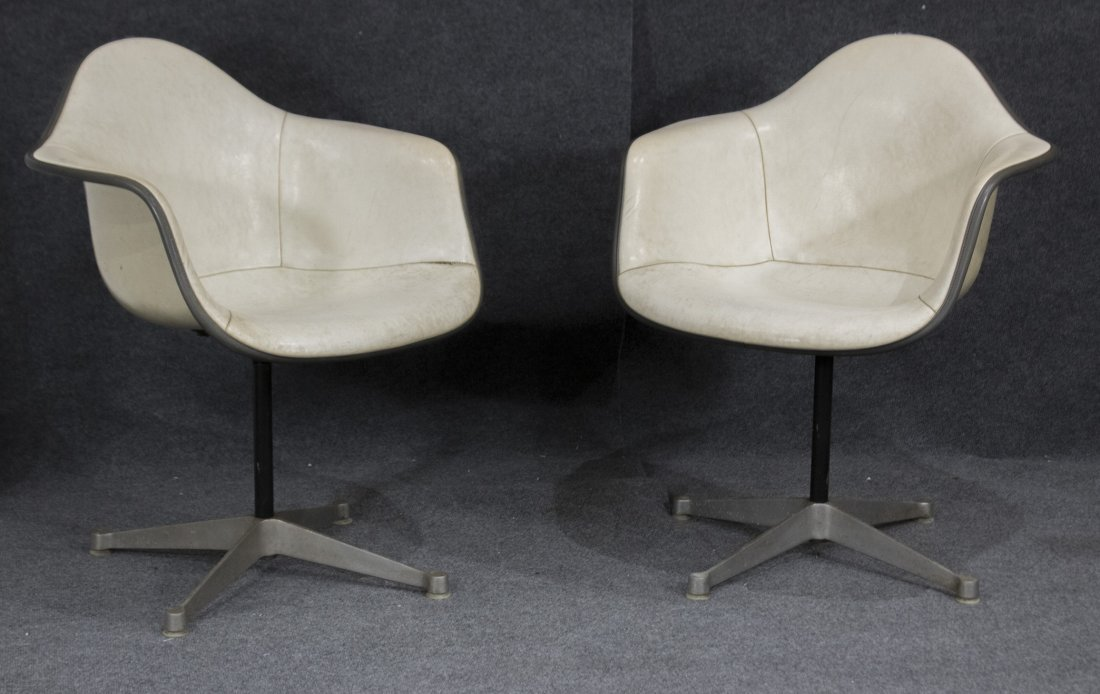 Pair HERMAN MILLER MCM white fiberglass arm chair