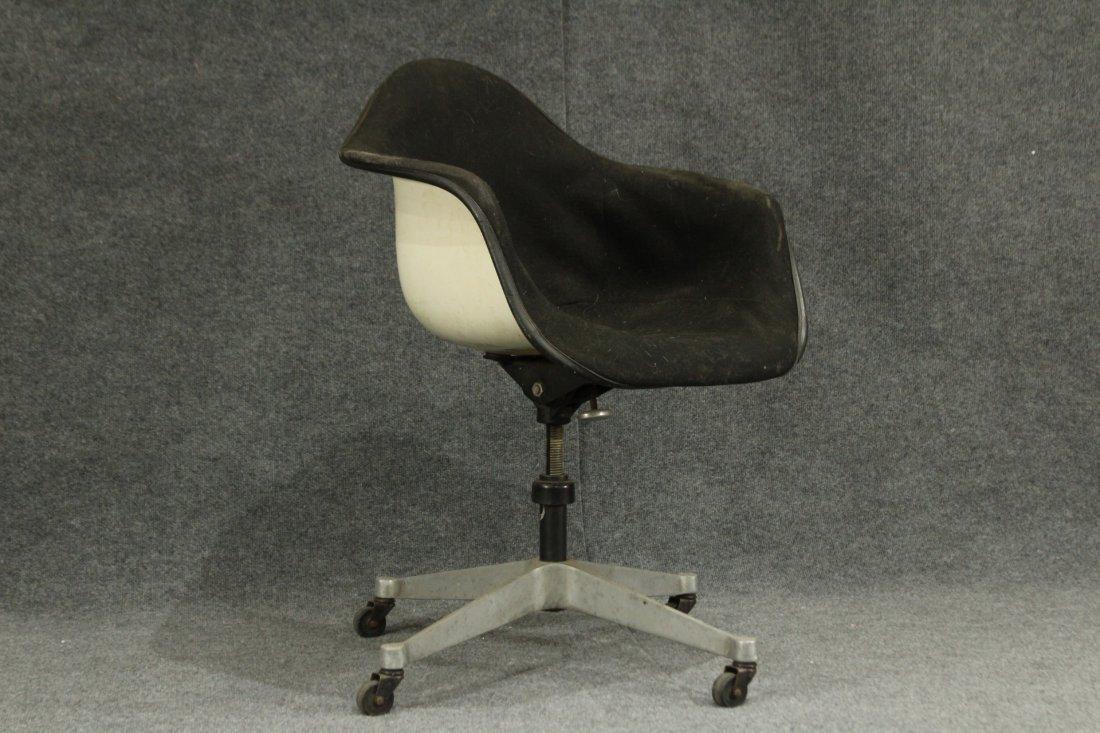 Herman Miller White fiberglass arm chair wheels