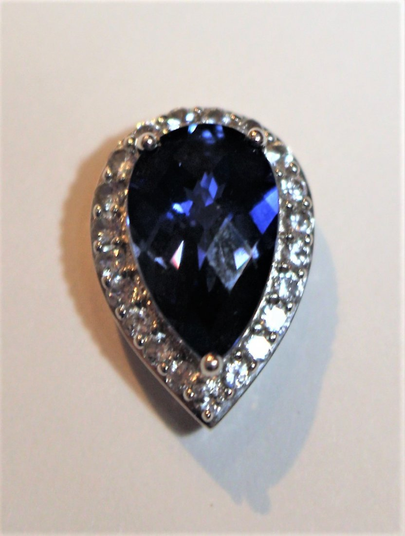10 K White Blue Sapphire Pendant With CZs