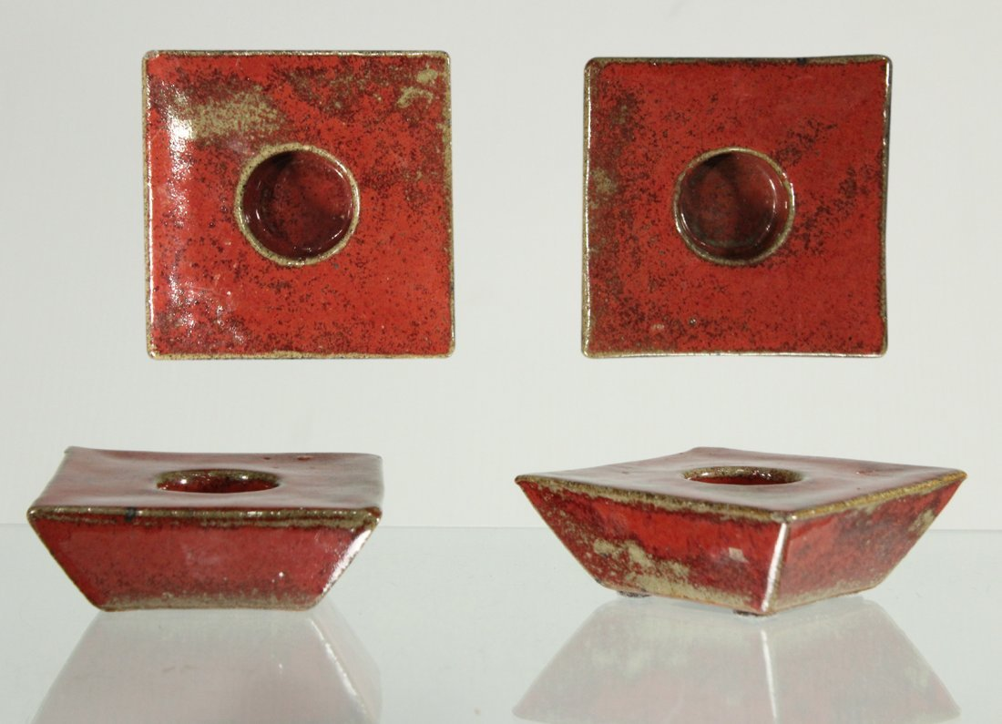 Pair MID CENTURY RED GLAZE ART POTTERY CANDLE HOLDERS