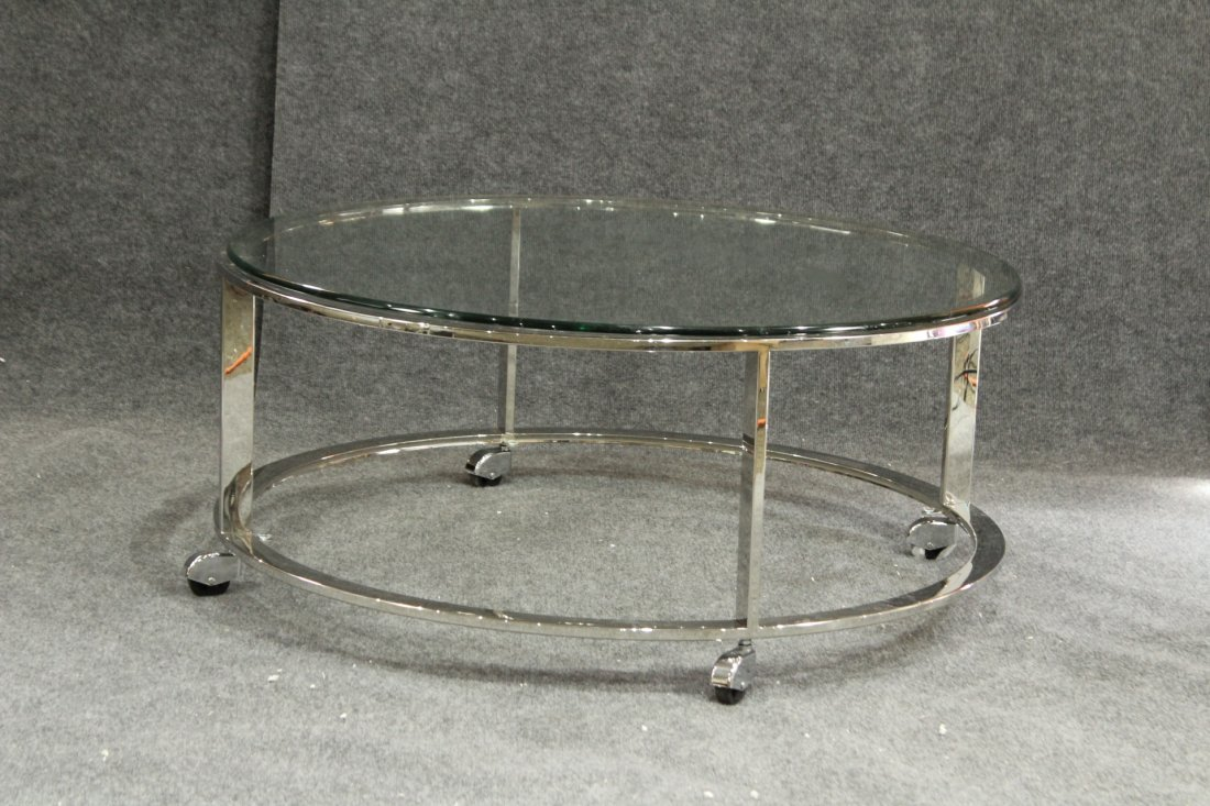 MILO BAUGHMAN style round chrome coffee table on wheels