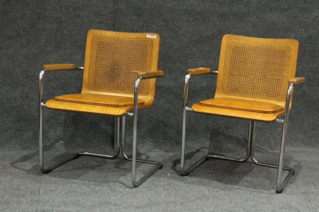Pair TUBULAR CHROME , CANE BACK, PLY SEAT ARM CHAIRS