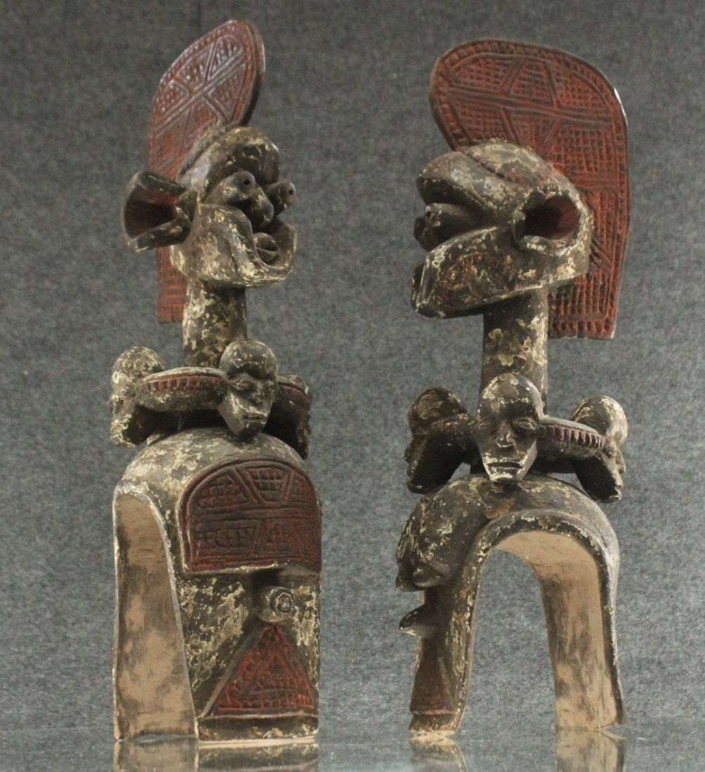 Pair of carved African ceremonial figurines