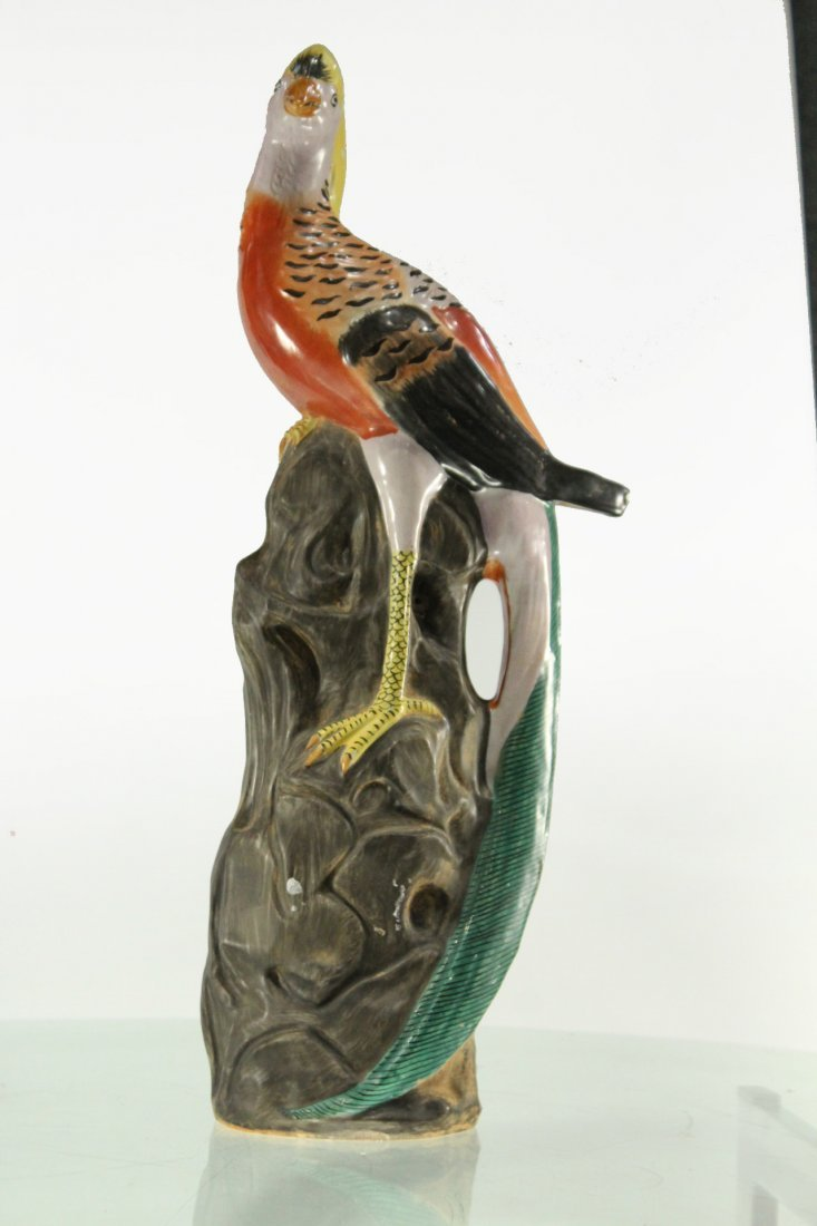 Vintage ceramic bird on rock