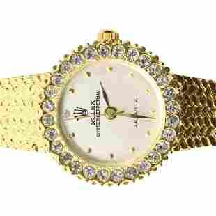 Faux Rolex Ladies Wristwatch in Gold Tone. Size: 7/8 in