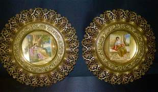 Pair of 19th Century scenic porcelain plates in ornate