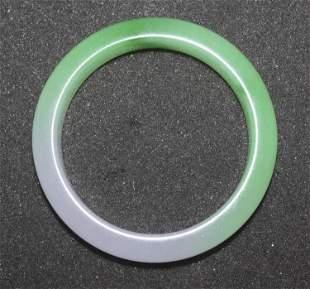 A Chinese Bicolor Jade Bangle Bracelet