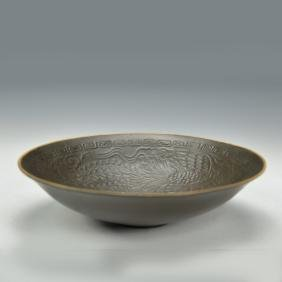 A Carame Dingyao Bowl with Dragon and Phoenix Pattern