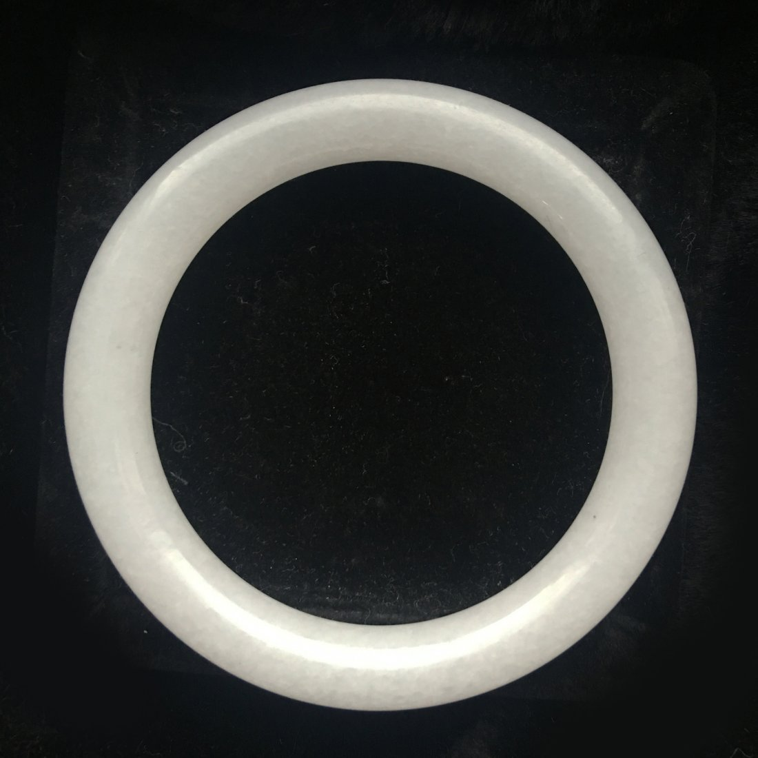 A WHITE JADE BANGLE