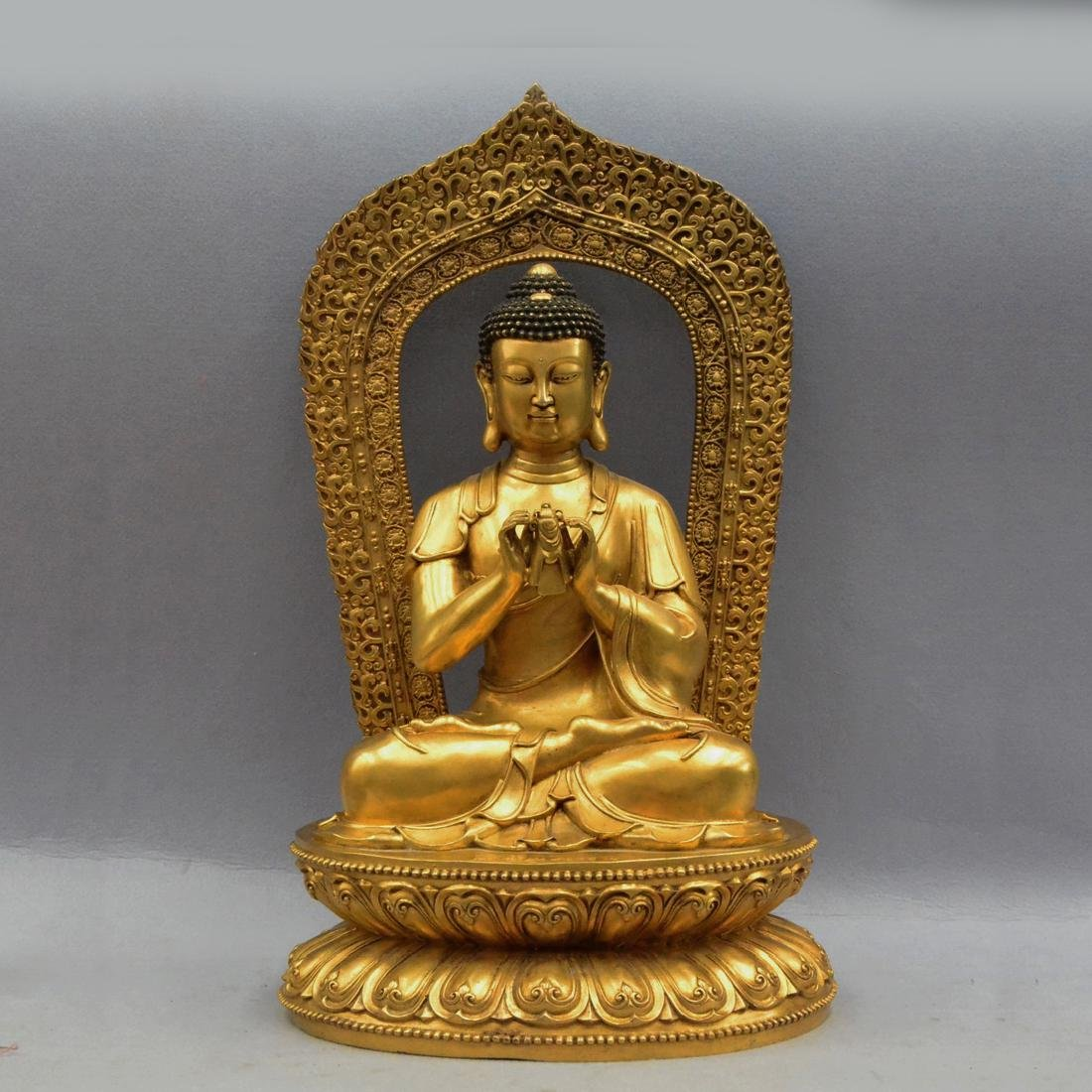 A GILT BRONZE BUDDHA FIGURE