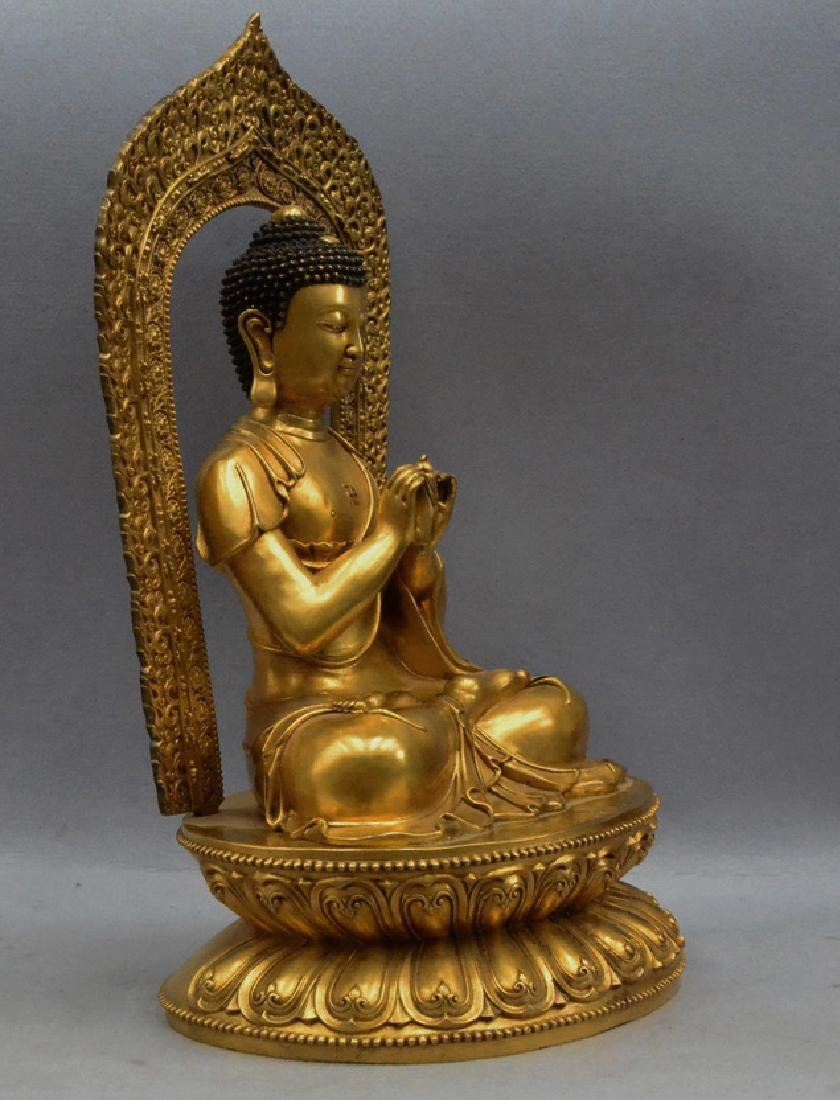 A GILT BRONZE BUDDHA FIGURE - 5