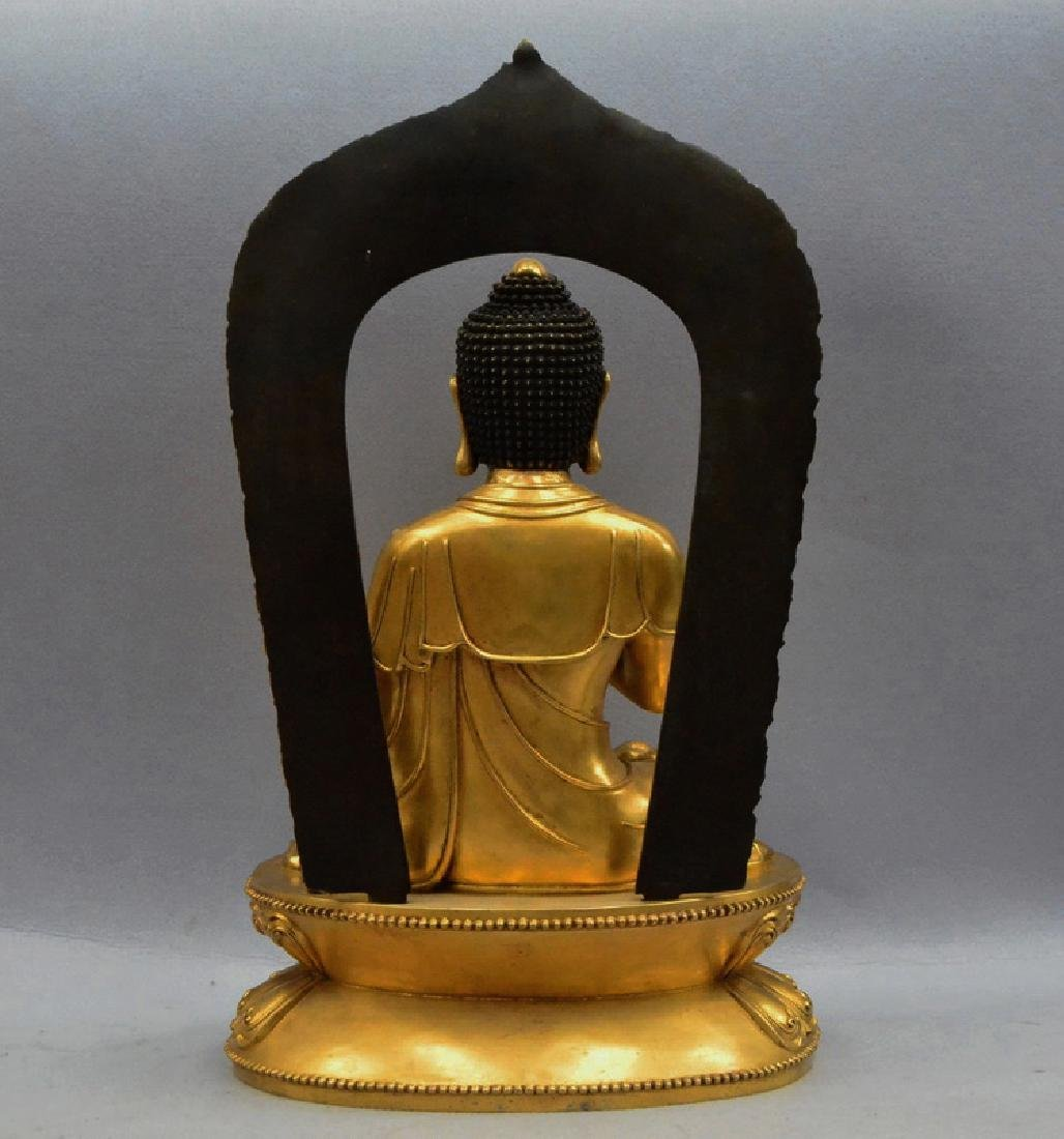 A GILT BRONZE BUDDHA FIGURE - 6