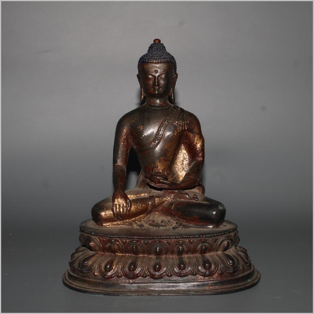 AN ANTIQUE TIBETAN GILT BRONZE BUDDHA STATUE