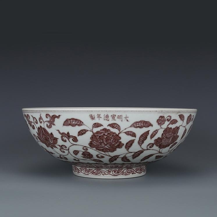 A COPPER RED BOWL WITH RED TWIGS AND PEONIES PATTERN