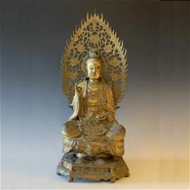 A QING DYNASTY GILT BRONZE GUANG YIN BUDDHA STATUE