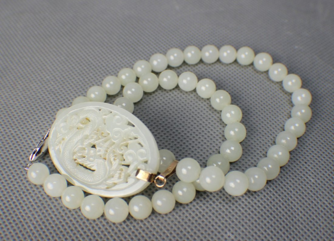 A Hetian White Suet Jade Necklace with a Pendant Carved - 3