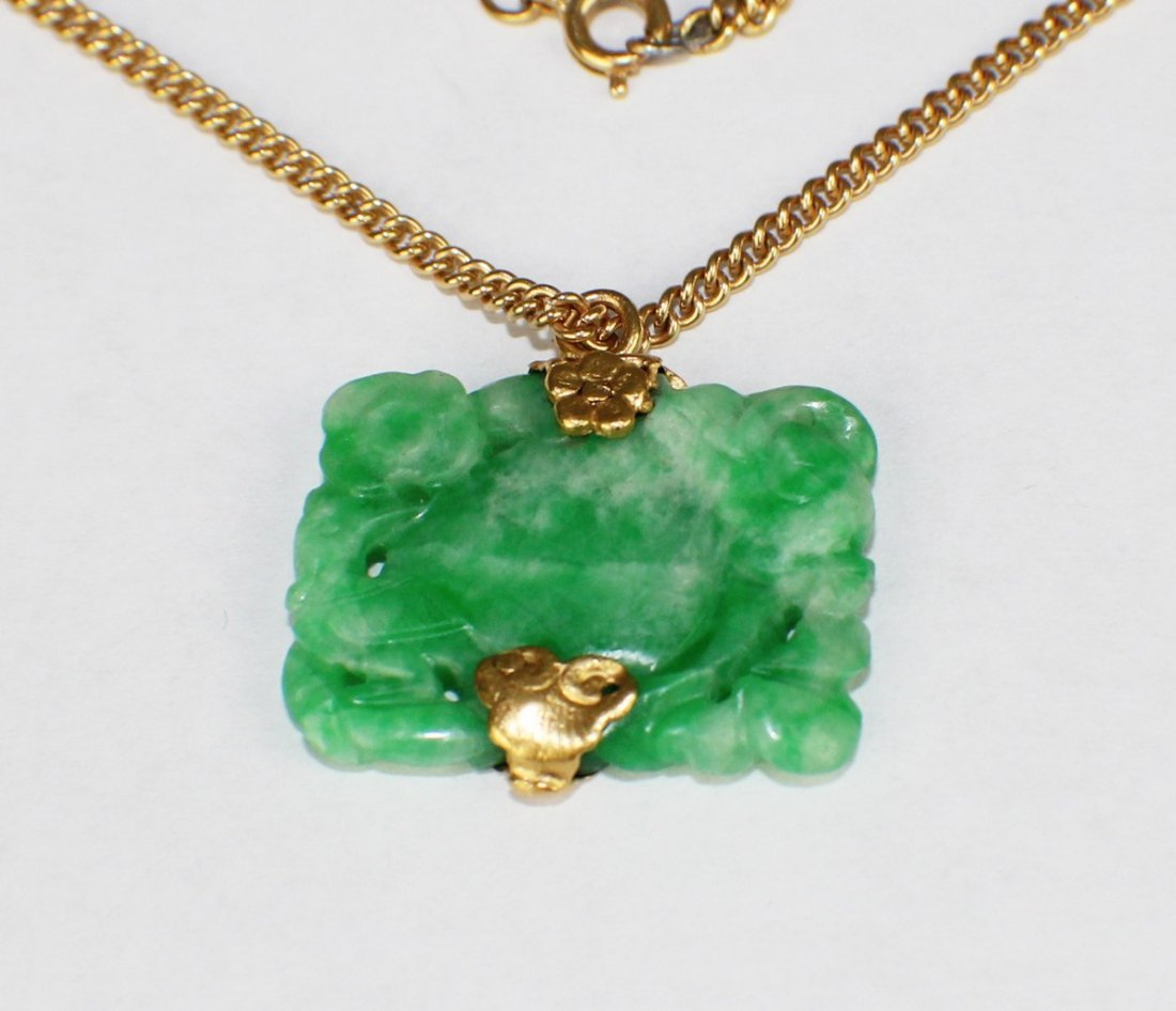 A LIGHT GREEN JADEITE PENDANT WITH 22K GOLD NECKLACE
